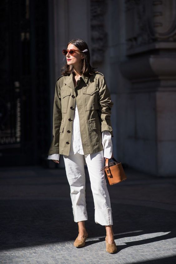 a white shirt, white jeans, tan mules, a green safari jacket, a brown bucket bag for spring