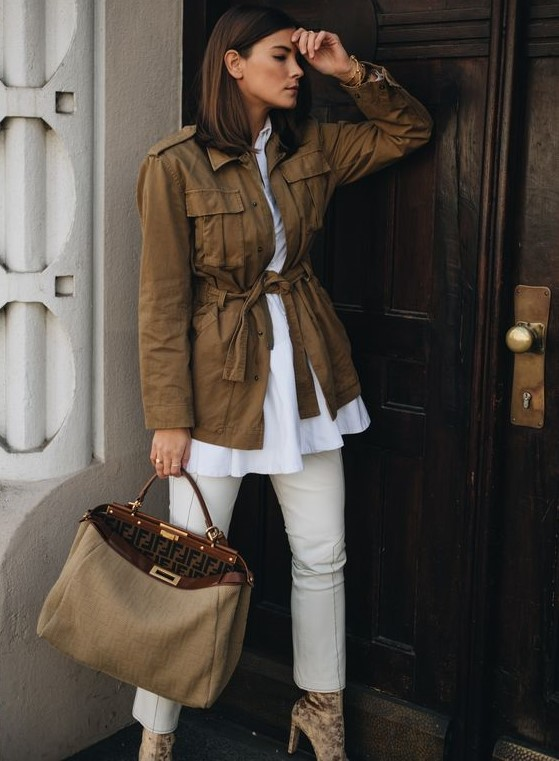 a white shirt, white pants, velvet booties, a brown safari jacket and a greige bag