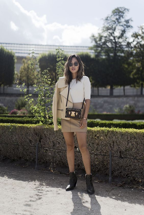 a white top, a tan leather mini, a creamy leather jacket and booties plus a black bag