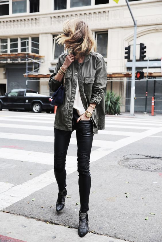 a white top, black leather leggings, black embellished shoes, a navy bag and a grey army jacket