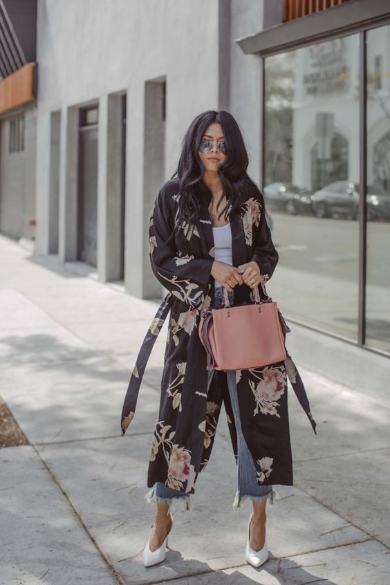 a white top, blue fringe cropped jeans, a dark floral duster, white heels and sunglasses