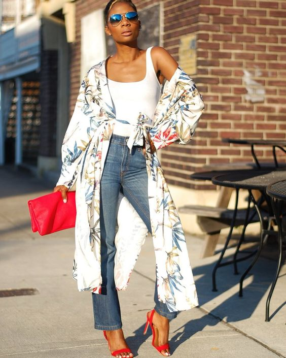 a white top, blue jeans, red shoes, a floral kimono and a hot pink clutch