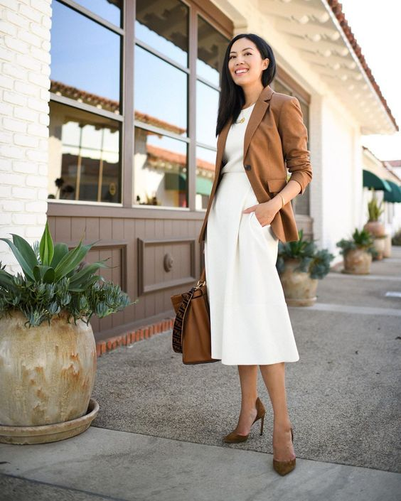a white top, creamy culottes, a brown blazer, brown shoes and a tote for a super elegant work look