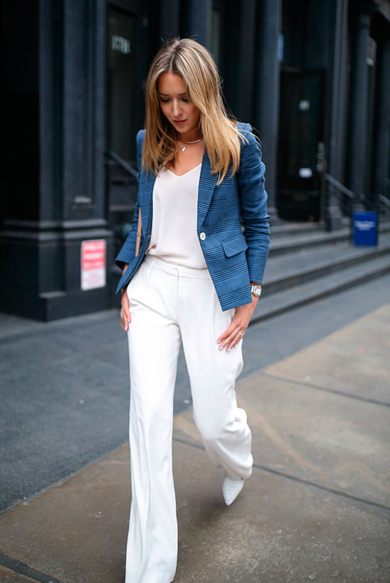 a white top, white pants, white shoes, a blue plaid blazer and layered necklaces for a chic look