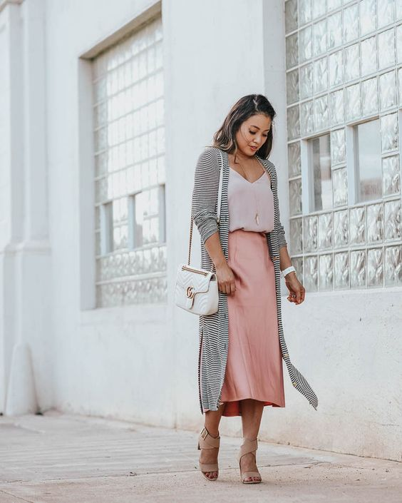 an elegant look with a blush top, a pink slip skirt, nude heels, a white bag and a striped duster