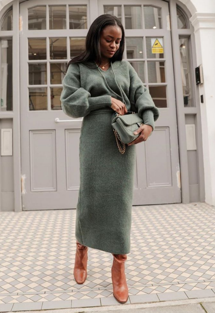 an olive green knitted jumper, a matching midi skirt, brown boots and an olive green bag for a feminine feel