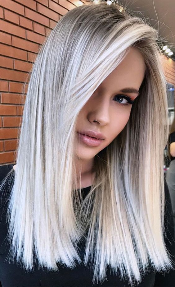 beautiful long blonde hair with balayage done in icy blonde and silver champagne is a refined and fresh idea