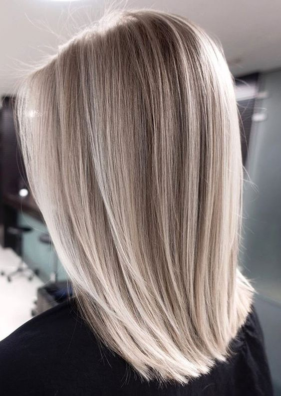 beautiful medium length blonde hair with silver champagne touches is amazing and chic