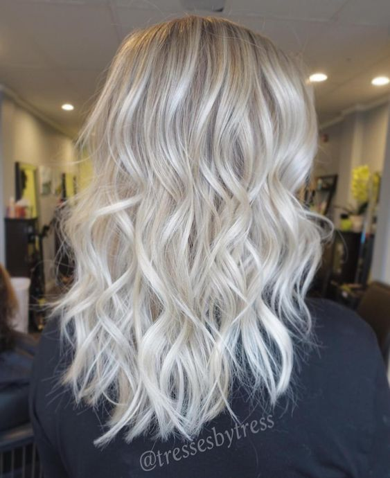 beautiful silver blonde hair with light waves is a very stylish and cool idea to rock