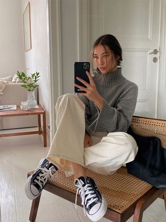 creamy wideleg pants, a grey turtleneck sweater, black Converse shoes for a cold spring day