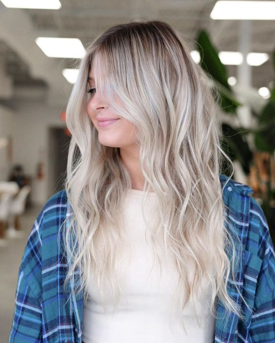 long rooty beach blonde hair with icy and ashy touches and waves is amazing for those who love colder shades