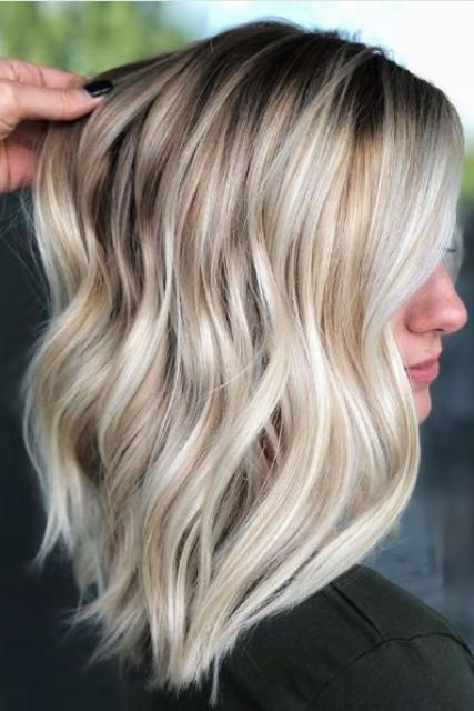 a cute summer icy blonde hairstyle