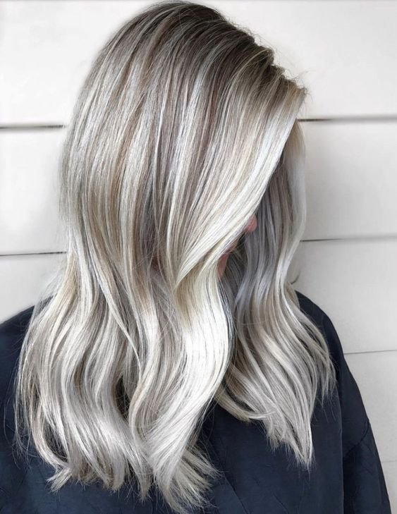 silver and icy blonde balayage with darker roots and waves is a chic idea
