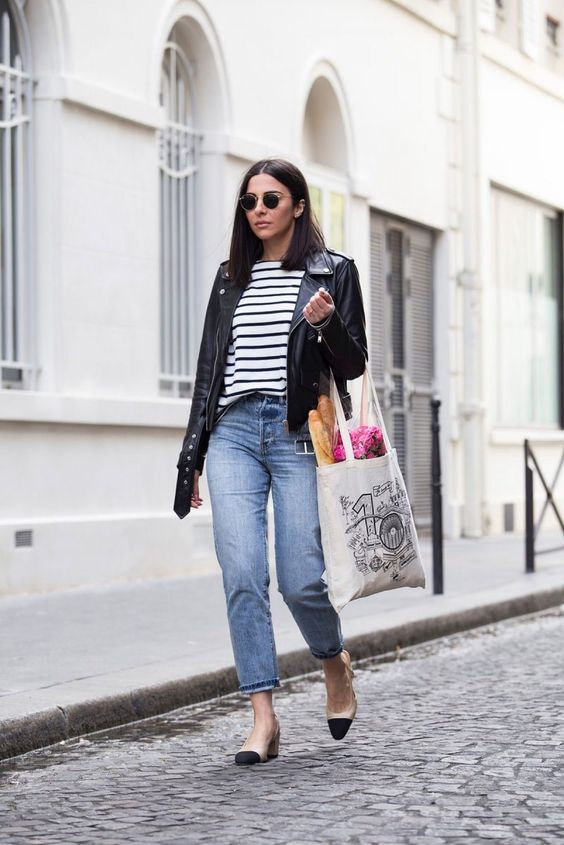 straight leg blue jeans, a striped top, a black leather jacket, two tone shoes and a tote for spring