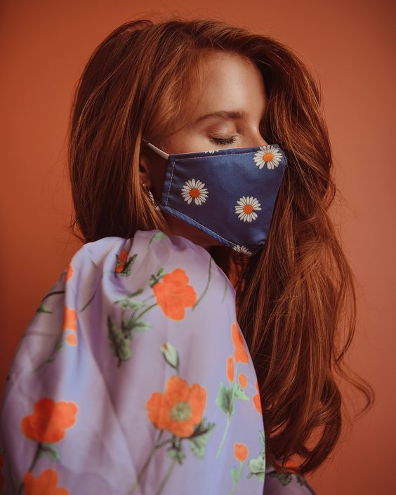 wear a floral print mask with a matching floral print outfit to make it look more delicate
