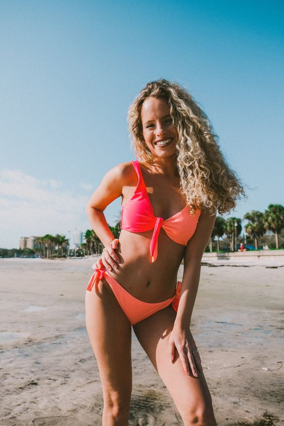 a bold color block bikini with a neon orange bottom and a top of neon orange and neon pink is extra bright