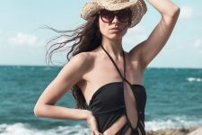 14 a black fully cutout one piece swimsuit is a bold and very sexy solution to rock