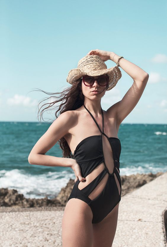 a black fully cutout one piece swimsuit is a bold and very sexy solution to rock
