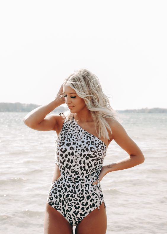 a one shoulder leopard print swimsuit with a cutout on the side is a fabulous idea for this season