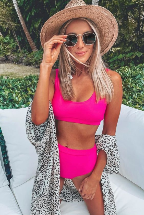 a neon pink swimsuit with a high waisted bottom and a comfy top plus a lovely hat