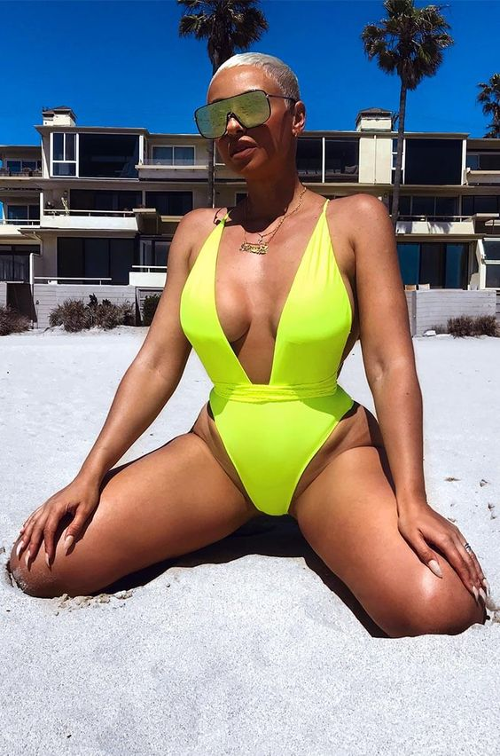 a neon yellow one piece swimsuit with a deep neckline and high cut bottom is a veyr sexy solution
