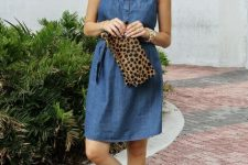 With beige and black hat, leopard printed clutch and golden flat sandals