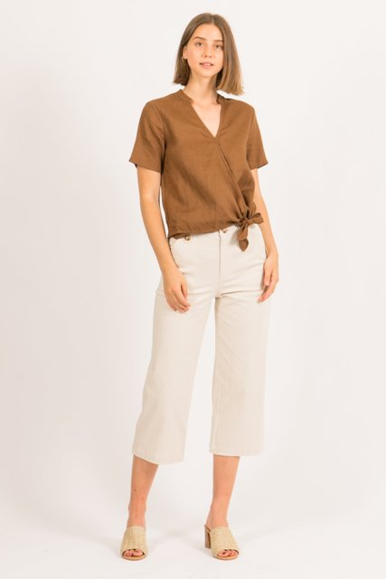 With beige culottes and beige heeled mules