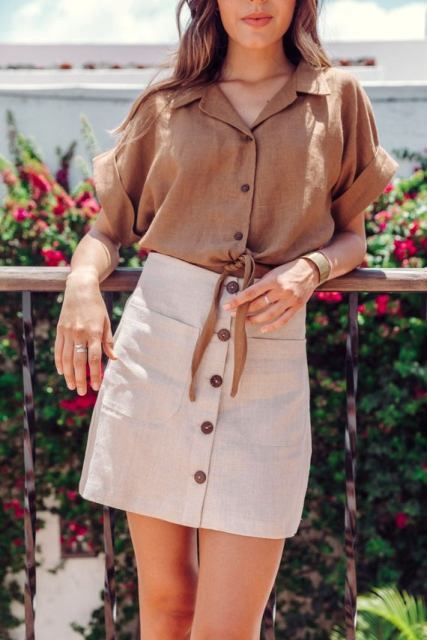 With beige high-waisted button front mini skirt