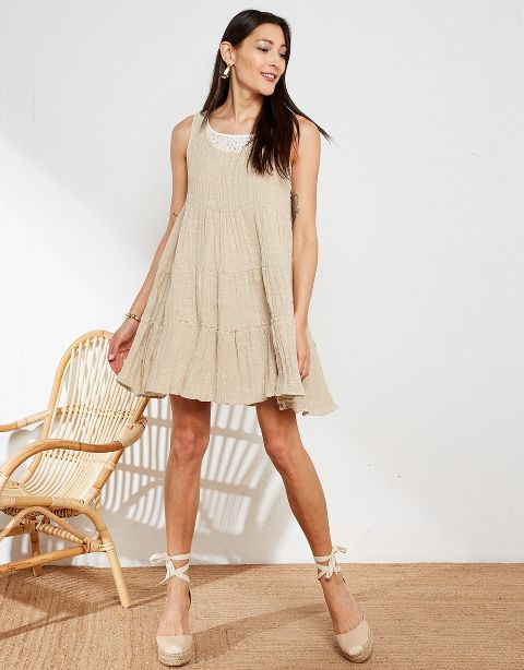 With beige lace up platform shoes and white lace top