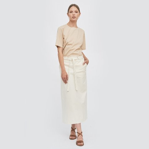 With beige shirt and brown lace up sandals