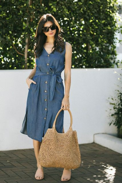 With beige tote bag, sunglasses and beige mules