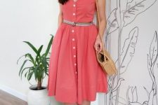 With beige wide brim hat, straw bag and beige ankle strap sandals