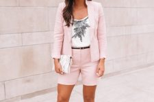 With black and white printed shirt, clutch and beige high heels