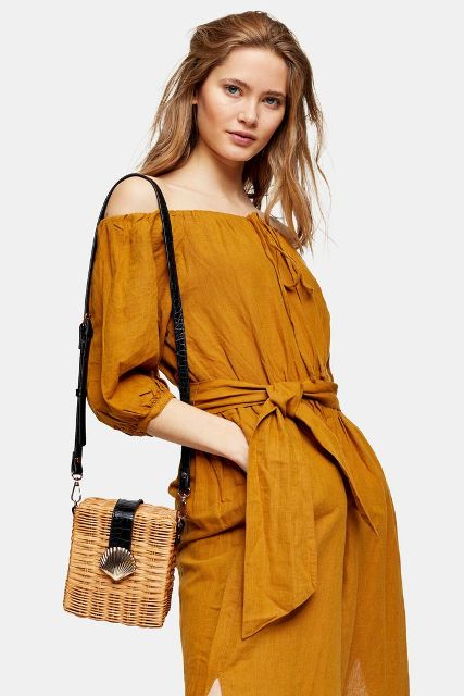 With black leather and straw bag