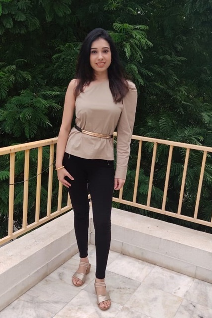 With black leggings and metallic shoes