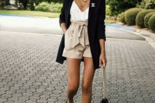 With black long blazer, white top, chain strap bag and black flat shoes