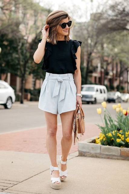 With black ruffled blouse, beige bag and platform sandals
