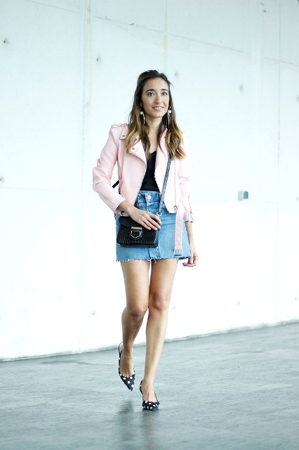 With black top, pale pink leather jacket and black bag