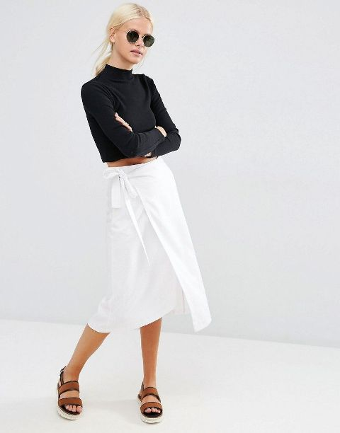 With black turtleneck, rounded sunglasses and brown sandals
