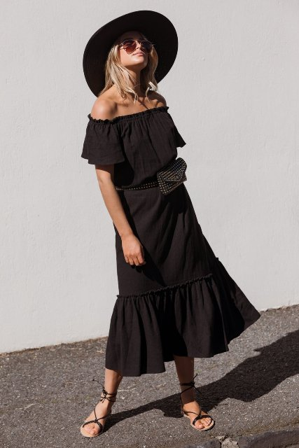 With black wide brim hat, embellished waist bag and lace up flat sandals