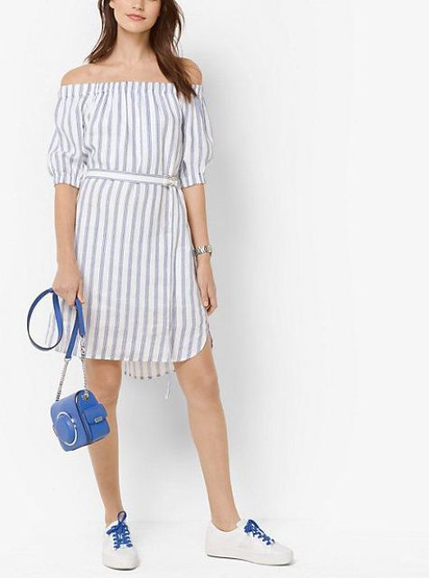 With blue chain strap bag and white and blue sneakers