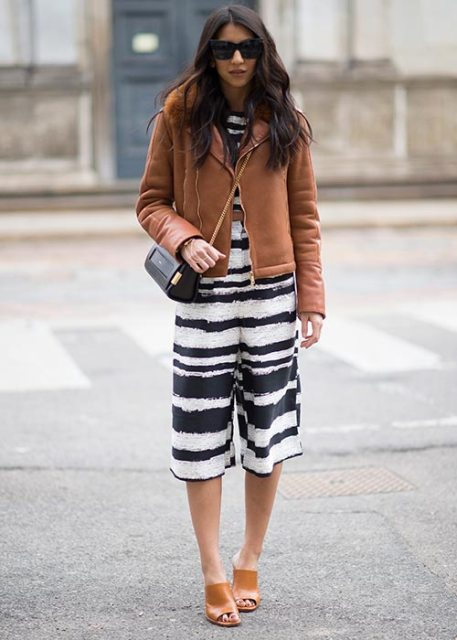 With brown jacket, chain strap bag and brown leather mules