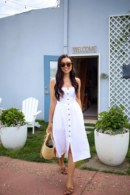 With brown leather flat sandals and straw tote bag