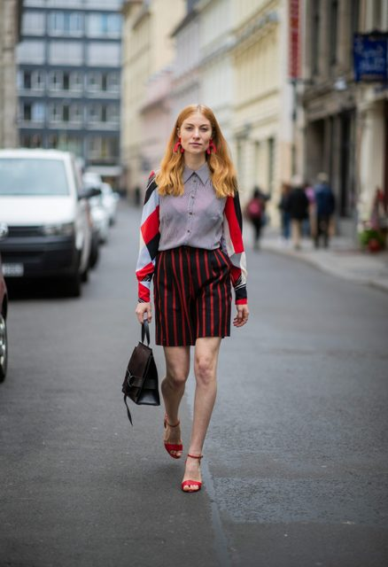 With button down shirt, black bag and red ankle strap shoes