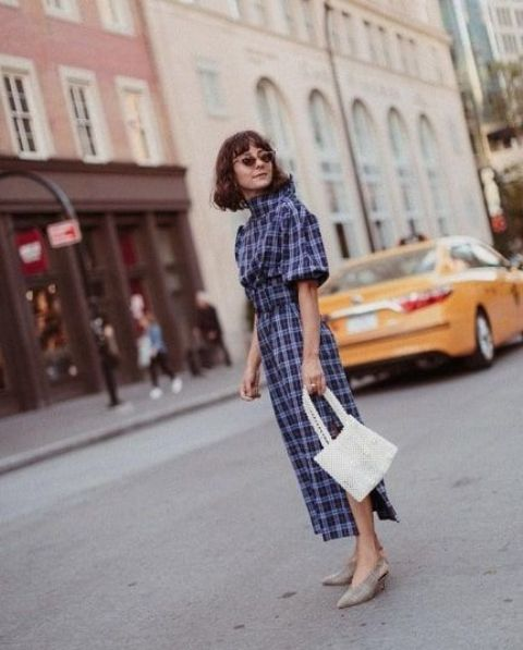With checked midi dress and white bag