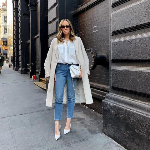 With crop jeans, white pumps, white chain strap bag and beige coat