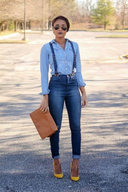 With denim shirt, brown leather clutch and yellow pumps
