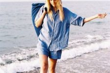 With denim shorts and navy blue bag