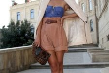 With denim top, beige blazer, leopard printed clutch and white flat shoes