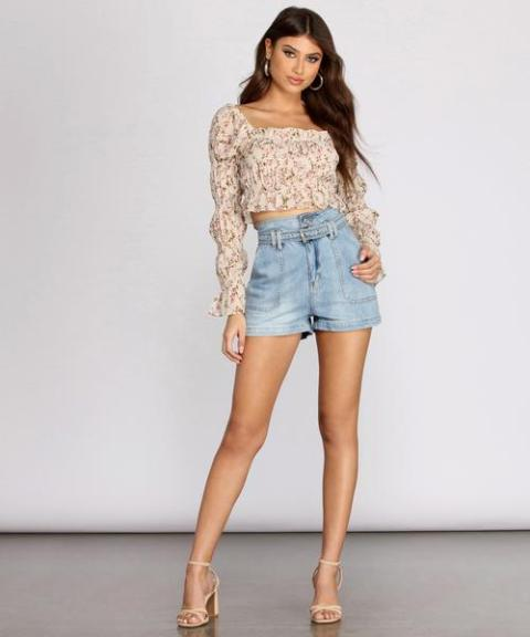 With floral crop blouse and beige ankle strap high heels